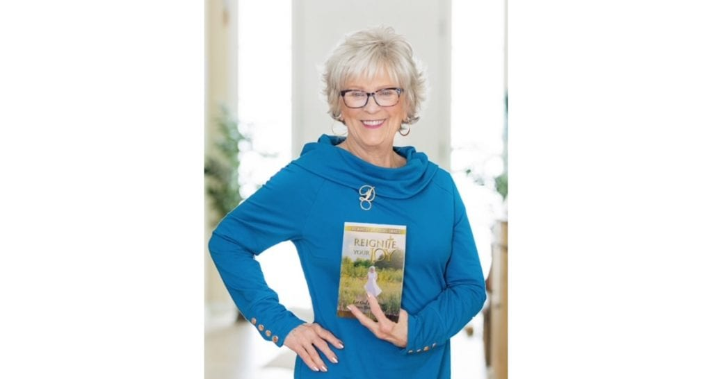 Author Dar Geiger with her new book, Reignite Your Joy